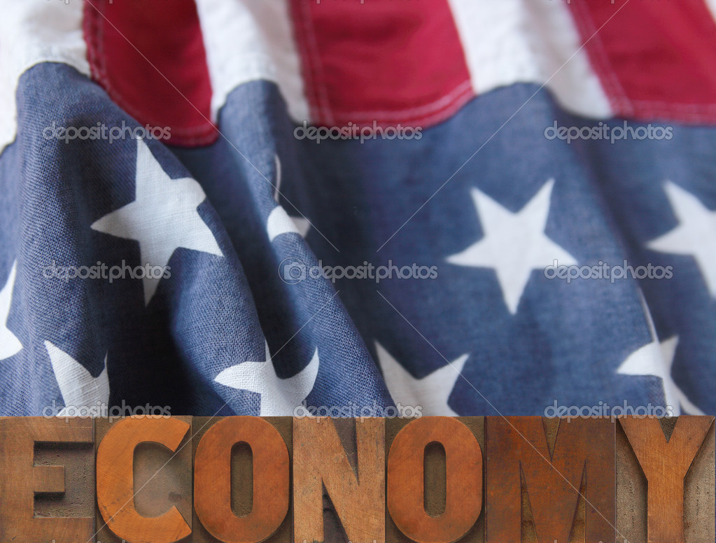 American flag with economy word in wood type  Stock Photo #2486592