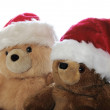 Two teddy bears in Santa hats — Stock Photo