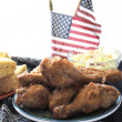 Fried chicken with flags — Stock Photo