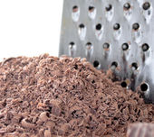Grated chocolate and grater — Stock Photo