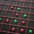 Red and green discs in red grid — Stock Photo #2595917