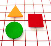 Three shapes on a grid — Stock Photo