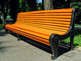 Orange bench for relaxation — Stock Photo