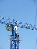 Big industrial functional metal crane — Stock Photo