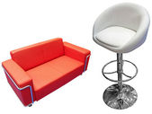Red divan and white chair — Stock Photo