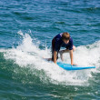 Stock Photo: Teenage Boy Surfing