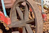 Old wheelbarrow wheel — Stock Photo