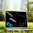 Stock Photo: Laptop on Grass with 3D Model