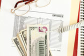 An invoice sheet showing big unpaid balance with telephone cord. — Stock Photo