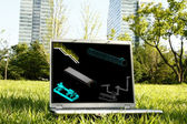 Laptop on Grass with 3D Model — Stock Photo
