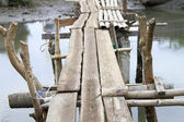 Makeshift bridge made of bamboo and wood — Stock Photo
