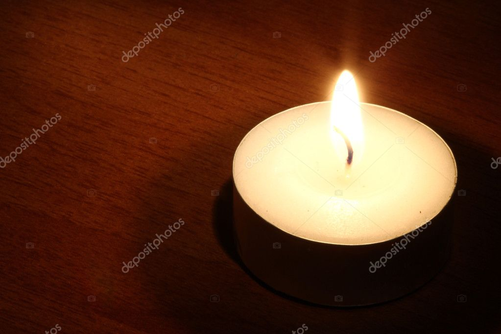 One Burning candle in the dark- many uses in religion or faith. — Stock Photo #2474035