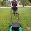 Stock Photo: Lawn mowing man