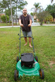 Lawn mowing man — Stock Photo