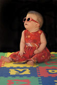 Baby with sunglasses — Stock Photo