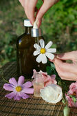 Flower essential oil and tincture — Stock Photo