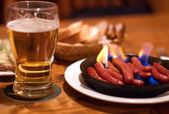 Beer and fried sausages — Stock Photo