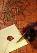 Letter , Quill, Inkwell on map — Stock Photo
