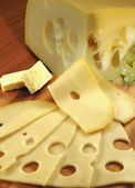 Cheese, butter and grapes — Stock Photo