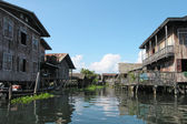 Stilt houses on river in Thailand — Foto Stock