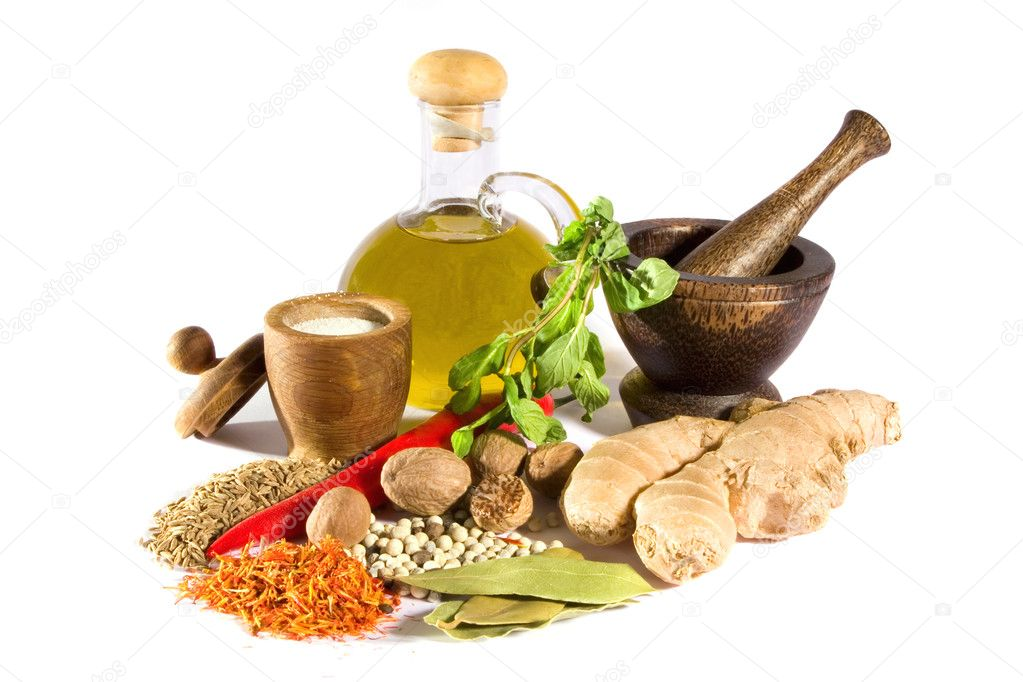 Spices, herbs, salt, olive oil and mortar with pestle isolated on white background.  Stock Photo #2232973
