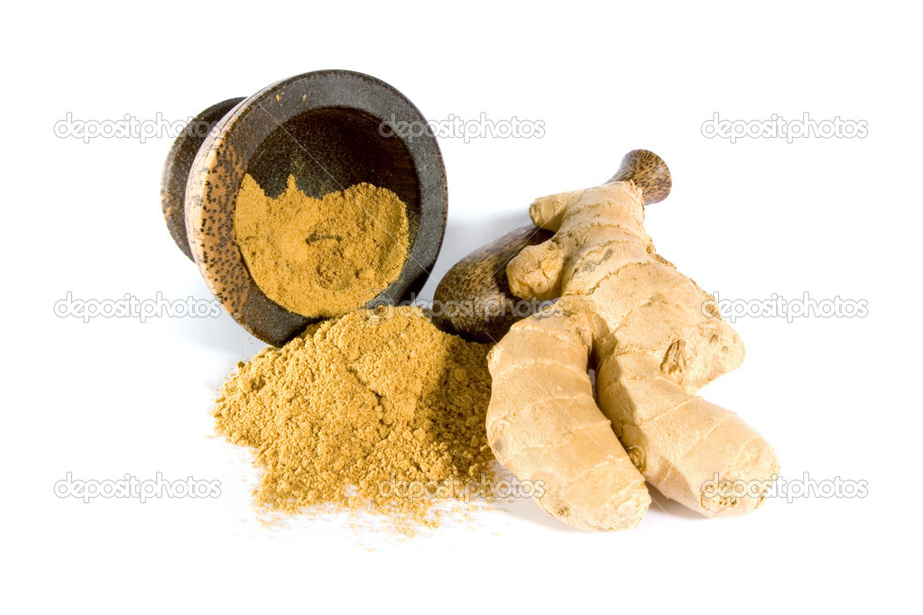 Ginger powder in a pestle and mortar with ginger root isolated on white background.   Stock Photo #2233038