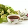 White roses bouquet and tea — Stock Photo