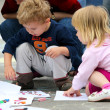 Children drawing on asphalt — Stock Photo
