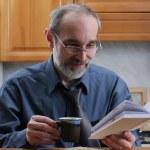Senior intelligent man reading book — Stock Photo