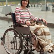 Woman in wheelchair  in park — Stock Photo