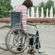 Woman in wheelchair overcomes steps — Stock Photo