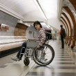 Stock Photo: Woman in wheelchair in subway