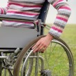 Woman propelling wheelchair — Stock Photo