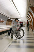 Woman in wheelchair in subway — Stock Photo