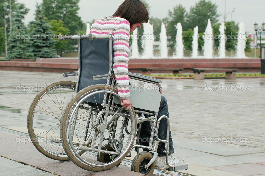 Woman in wheelchair extreme overcomes steps   Stock Photo #2267498