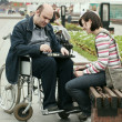 Man on a wheelchair in park — Stock Photo