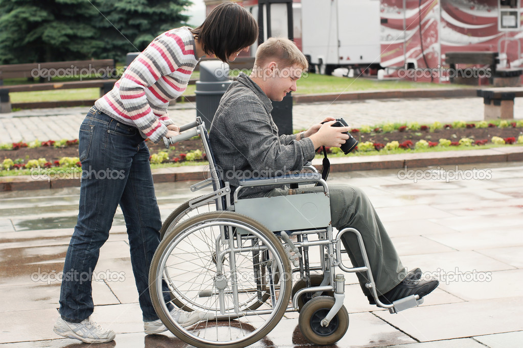Joyful man on a wheelchair looking image in the camera — Stock Photo #2289591