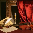 Stock Photo: Violin, candle and feather