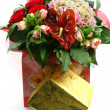 Gift box with bouquet — Stock Photo