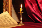 Candle and a music sheet. — Stockfoto