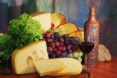 Cheese, grape and wine. — Stock Photo