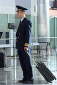 Air steward at airport — Stock Photo