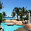Swimming pool and tropical beach — Stock Photo