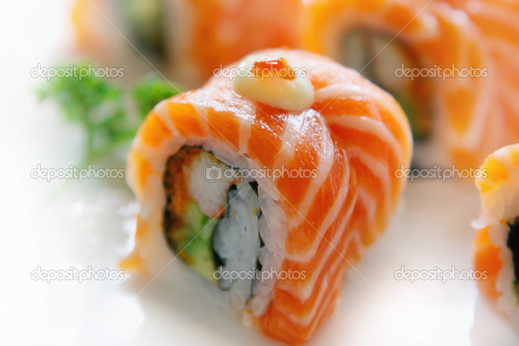 Rolls Philadelphia with salmon and caviar on white dish. — Stock Photo #2310140