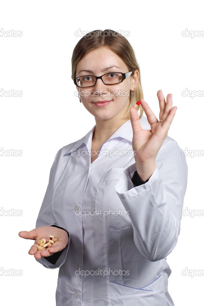 Doctor shows patients of a tablets and vitamins — Stock Photo #2387146