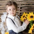 Beautiful little girl with flowers — Стоковое фото