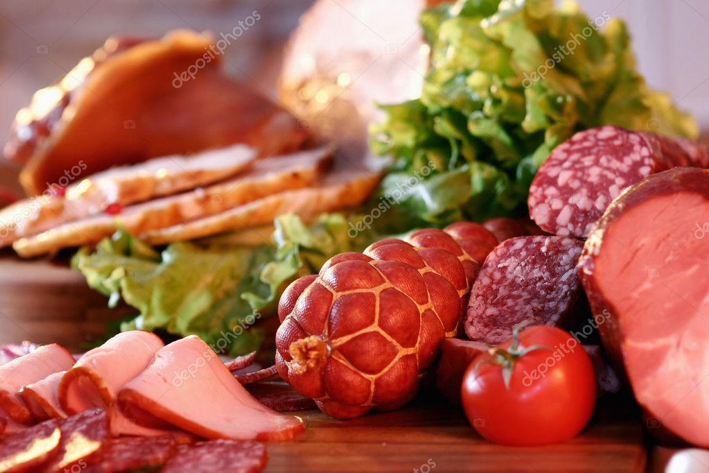 Still-life with smoked pork, sausage, tomato and green salad  Foto de Stock   #2397147