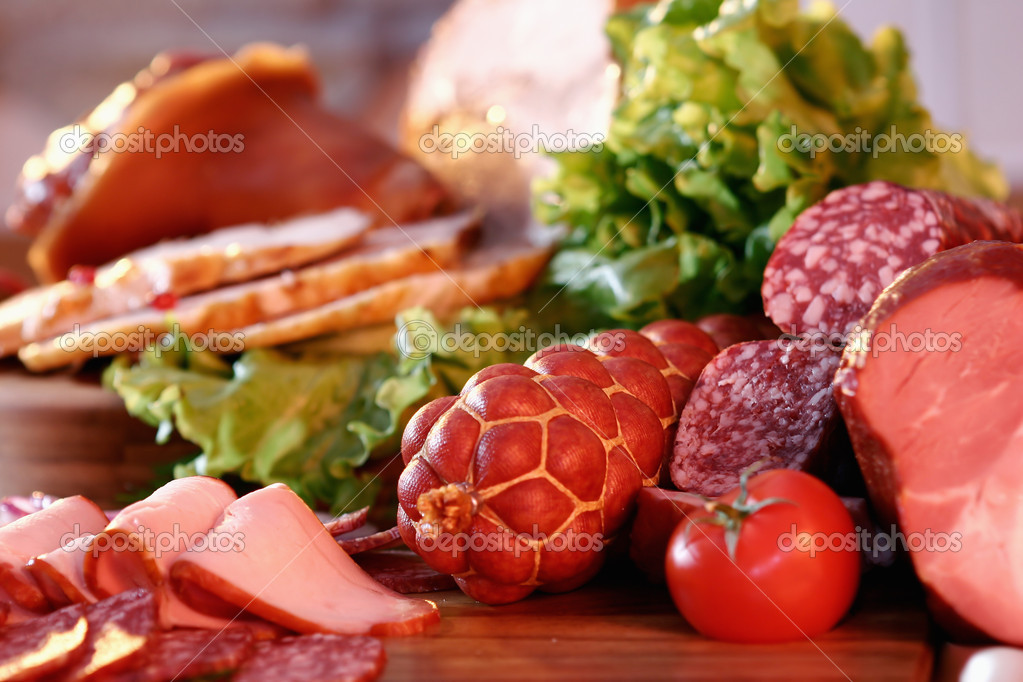 Still-life with smoked pork, sausage, tomato and green salad  Stockfoto #2397147