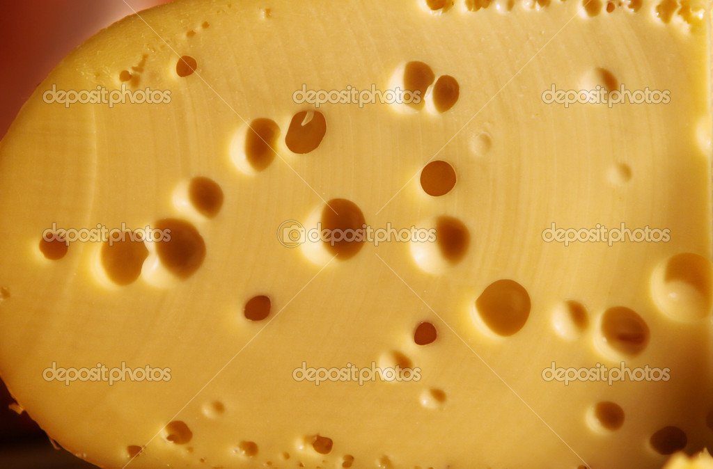 Swiss cheese background.  Close-up.  Stock Photo #2397225
