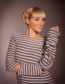 The beautiful blonde in a striped jacket — Stock Photo